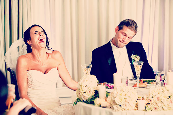 Bride and groom laughin
